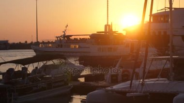 Russiam Sochi, 12 july 2017. Luxury yachts at amazing golden sunset sea water on promenade with lens flare effects. slow motion. 3840x2160