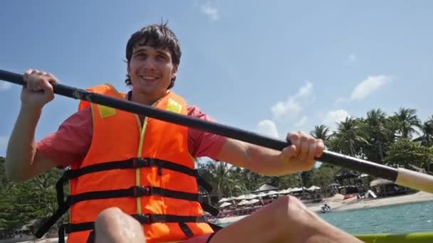 4be686f324 Young handsome Guy Paddling On Kayak Boat In Sea in slow motion. 1920x1080– stock  footage