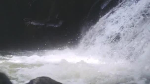 Clean fresh mountain water flowing between rocks in waterfall. slow motion. 1920x1080