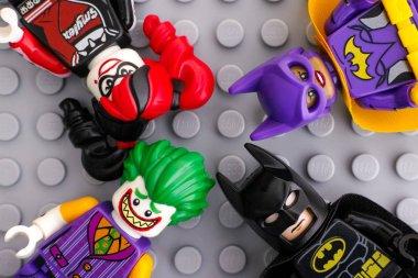 Four Lego Batman Movie minifigures - Batgirl, Batman, The Joker,