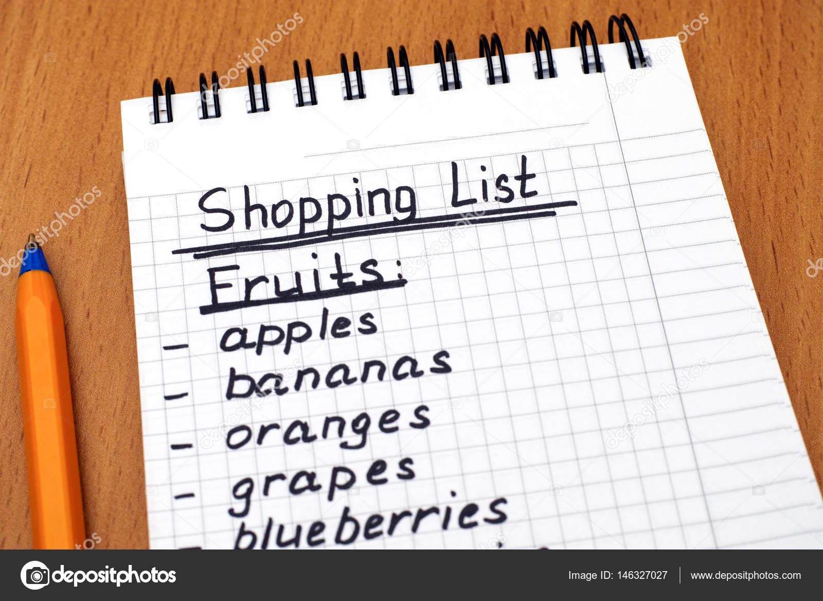 handwritten shopping list of fruits with pen — stock photo