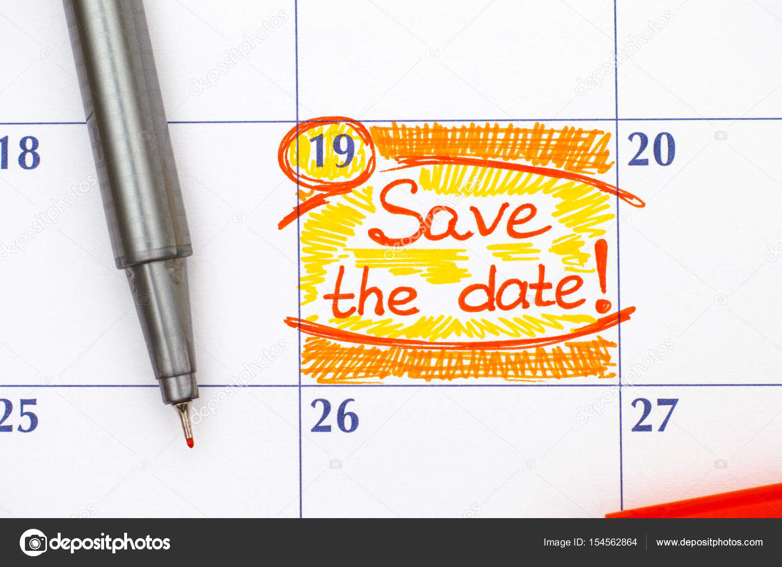 reminder save the date in calendar with pen stock photo