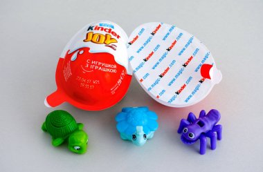 Kinder Joy eggs with three Kinder toys