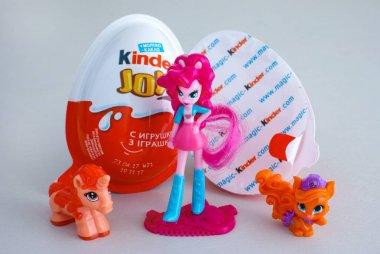 Kinder Joy eggs with three girl Kinder toys