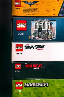 Lego boxes in stack. Black background.