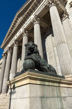 MADRID, SPAIN - JANUARY 22, 2018: Lion sculpture in front of Building of Congress of Deputies (Congreso de los Diputados) in City of Madrid, Spain