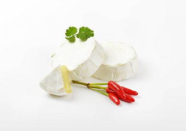 Wheels of soft white cheese
