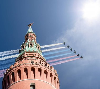 Russian military aircrafts fly in formation over Moscow during V