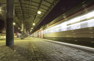 Train on Moscow passenger platform (Savelovsky railway station)-- is one of the nine main railway stations in Moscow, Russia (at night)