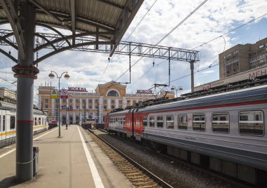 Train on Moscow passenger platform (Savelovsky railway station)-- is one of the nine main railway stations in Moscow, Russia