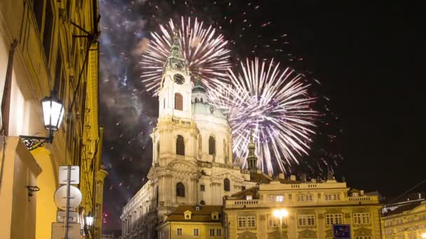 Nicholas Church in Mala Strana or Lesser side and holiday fireworks , beautiful old part of Prague, Czech Republic (Night view)