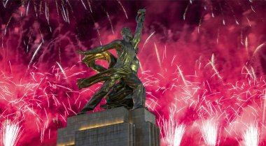 Soviet monument Rabochiy i Kolkhoznitsa ( Worker and Kolkhoz Woman) of sculptor Vera Mukhina (made of in 1937)  and fireworks in honor of Victory Day celebration (WWII), Moscow, Russia