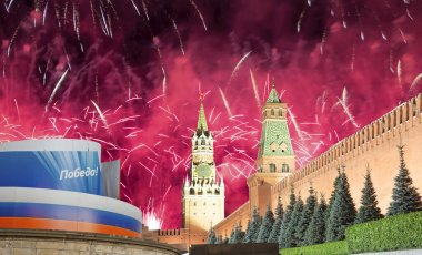 Moscow Kremlin and fireworks in honor of Victory Day celebration (WWII),  Red Square, Moscow, Russia.  English translation from Russian: Victory!