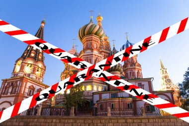 Coronavirus in Moscow, Russia. Temple of Basil the Blessed. Quarantine sign. Concept of COVID pandemic and travel.