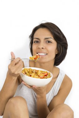 Attractive woman having breakfast