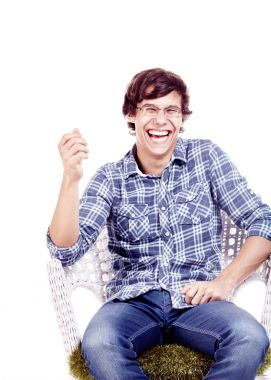 Laughing man on chair