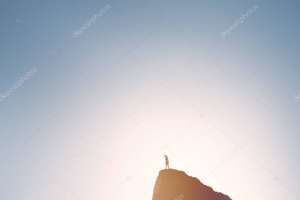 Winning girl on top of mountain