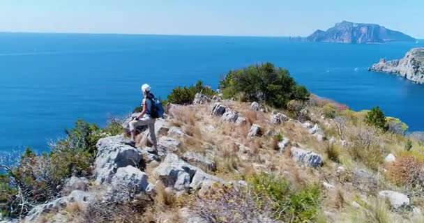 Young woman hiking in mountains over Amalfi coast. Slow motion