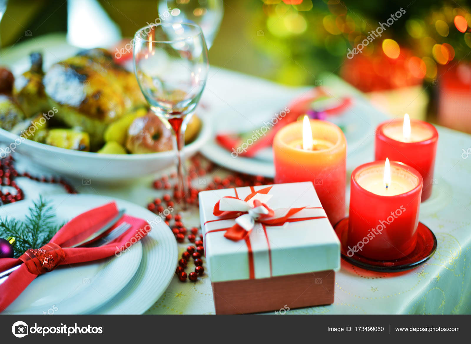 Closeup shot of beautiful table setting for Christmas dinner with little gift box and candles u2014 Photo by Taden1 & table setting for Christmas dinner u2014 Stock Photo © Taden1 #173499060