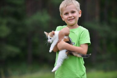 boy playing  with motley cat