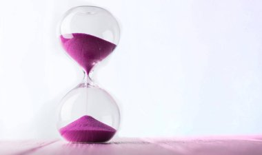 Hourglass with pink sand.