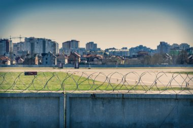 City behind barbed wire.