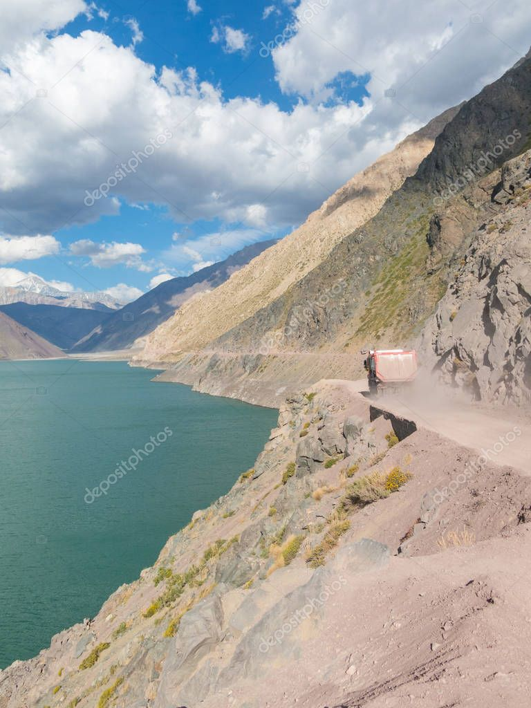 A truck that transports sand crosses the road of the Maipo Canyo