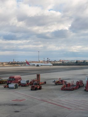 A plane prepares to take off on the runway of Terminal T4 the Adolfo Suarez Madrid Barajas Airport. Barajas is the main international airport in Madrid. Spain