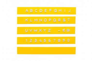 Embossed alphabet on yellow plastic tape, isolated on white stock vector