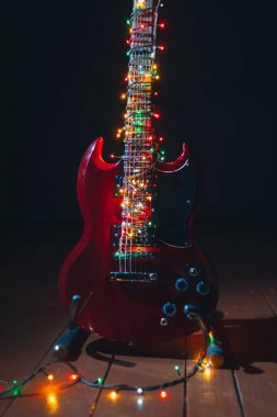 electric guitar with festive Christmas lights