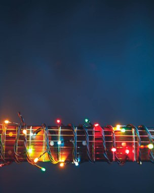 guitar finger-board with multicolor lights, festive background