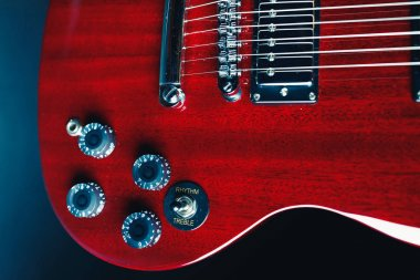 part of red guitar, close-up view