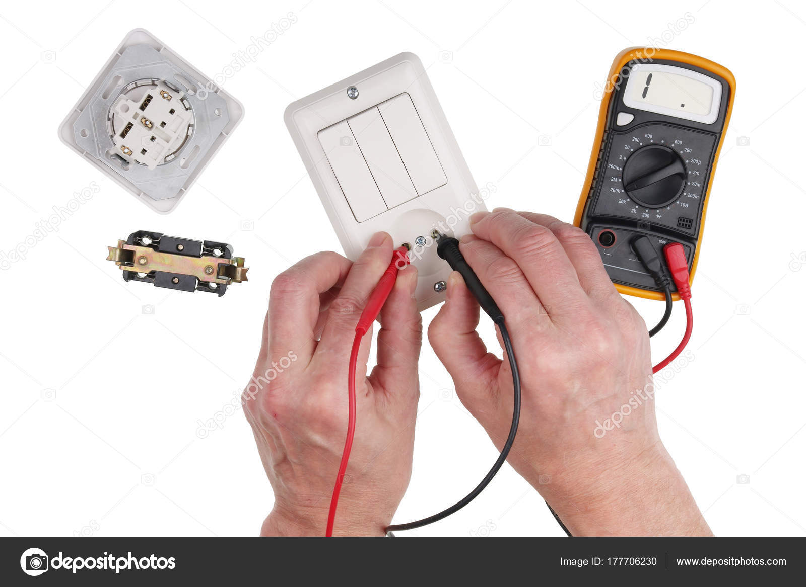 An elderly household electrician checks the isolation of the swi ...