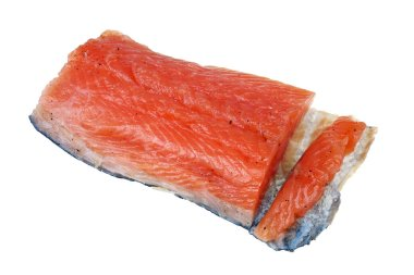 A large piece of delicious salted filet of Norwegian salmon isol