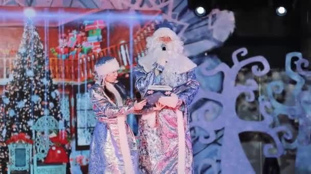 SAINT PETERSBURG, RUSSIA - DECEMBER 20, 2016: Ded Moroz and Snegurochka on theatre scene at kids new year concert