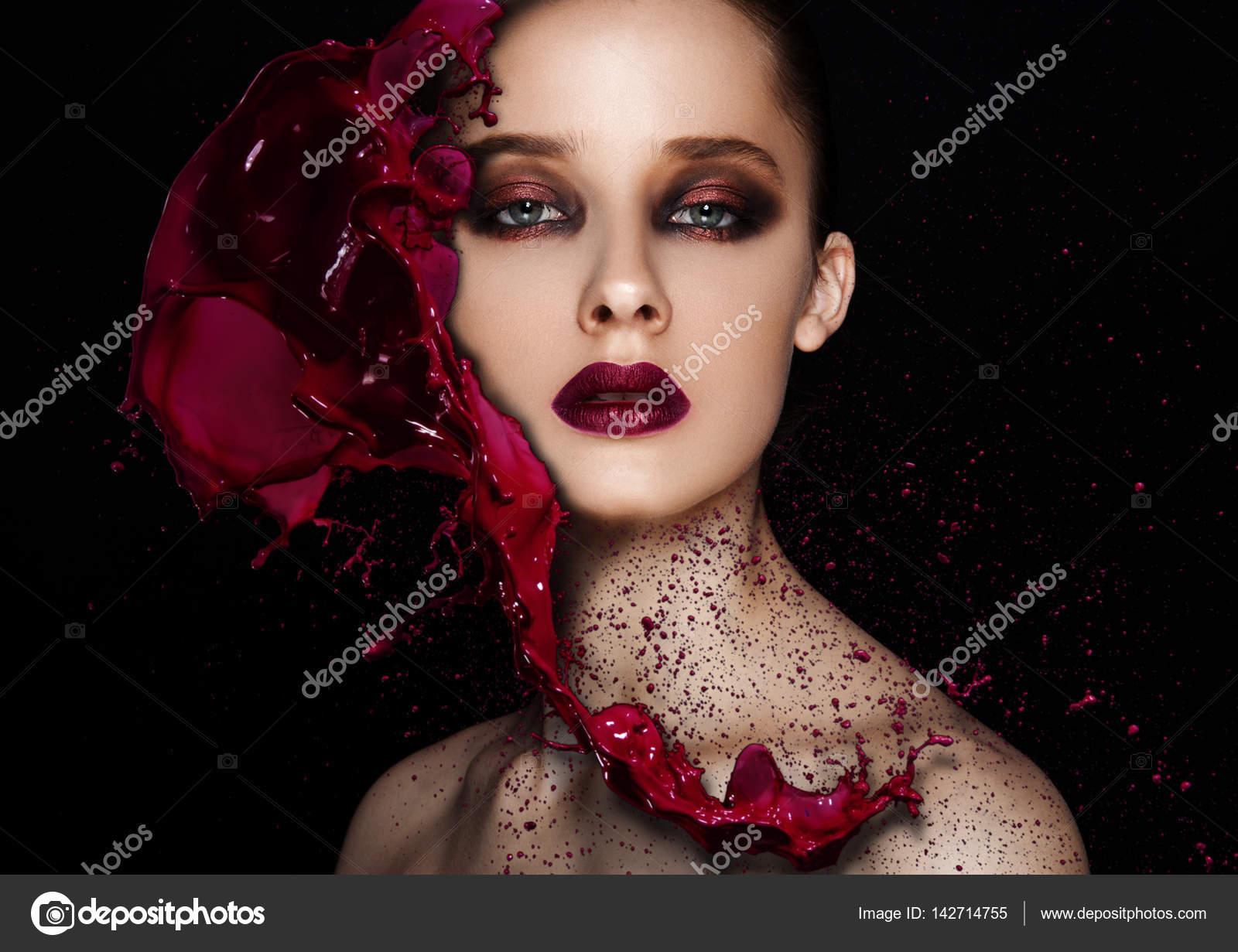 Red paint splash over beauty makeup model girl \u2014 Stock Photo