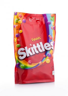 LONDON, UK -DECEMBER 07, 2017: Skittles Candy Pack on white. Skittles is a brand of fruit flavoured sweets.