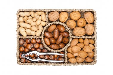 Basket reach in various kinds of nuts in shells