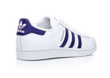 LONDON, UK - JANUARY 24, 2018: Adidas Originals Superstar blue shoes on white.German multinational corporation that designs and manufactures sports shoes, clothing and accessories.