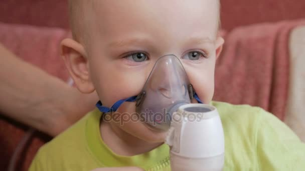 Mother holds the mask on the baby inhaler and breathes the medicine at  home  Treats inflammation of the airways via nebulizer  Preventing asthma  and cough