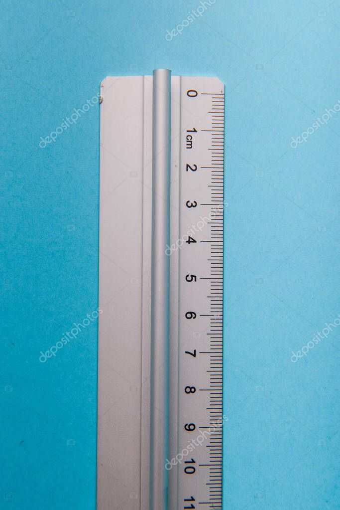 aluminum ruler on blue background