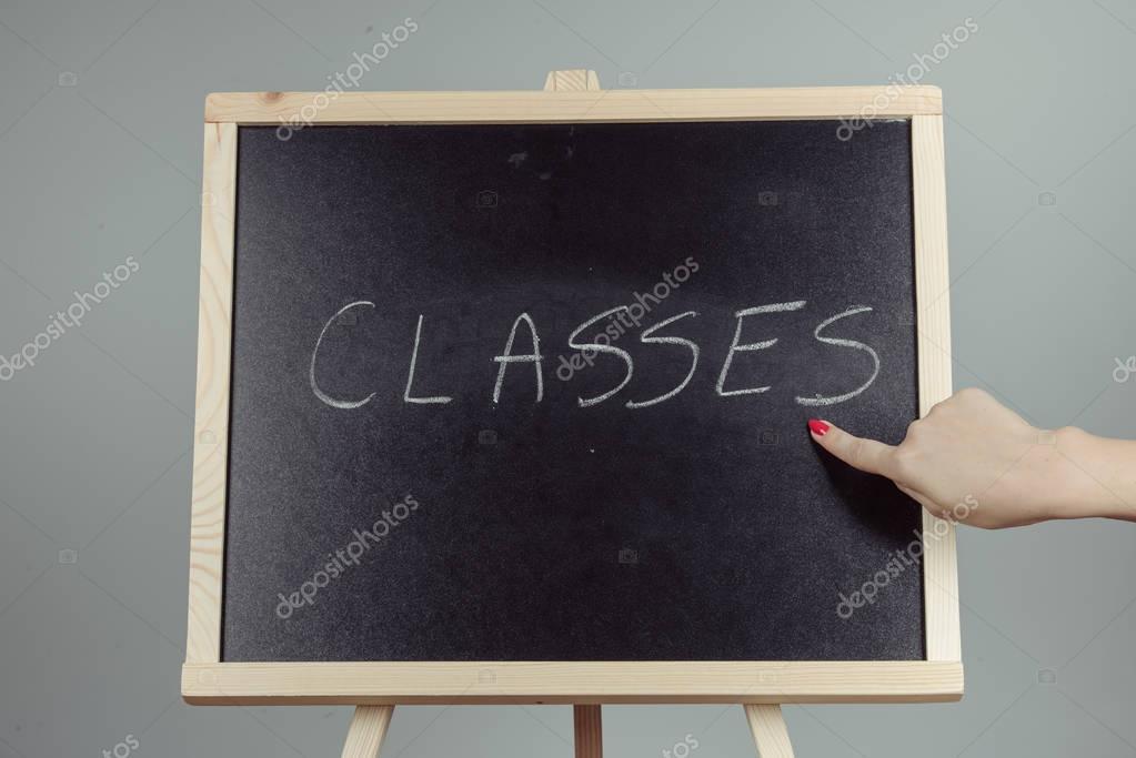 Classes written in white chalk on a black chalkboard