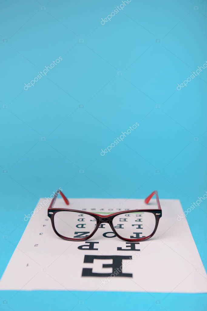 glasses lying on snellen test chart