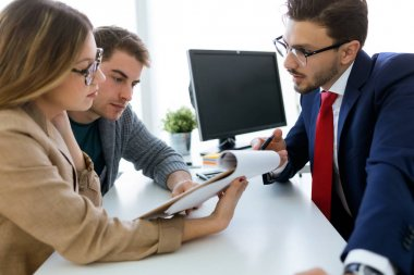 Business man explaining terms of contract to his clients in the