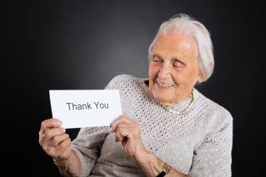 Elder Woman Showing Thank You Card