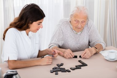 Two Women Playing Domino Game