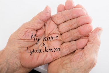 Hand Of A Dementia With Her Name