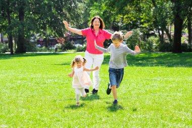 Grandmother And Grandchildren Running