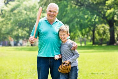 Grandson And Grandfather Playing Baseball