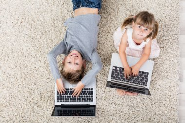 Two Children With Laptops